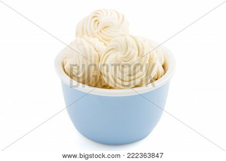 Homemade zephyr or marshmallow in blue plate  isolated on white background. Marshmallow, Meringue, Zephyr