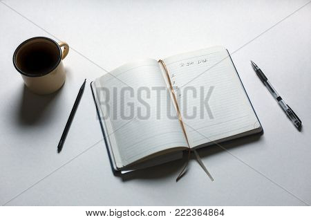 Opened Personal Organizer With A To Do List In Morning On White Background