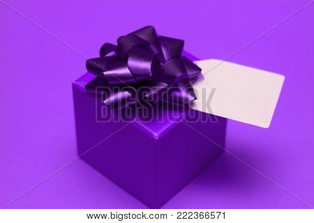 gift box with festive box and blank label for text painted ultra violet.demonstration color 0f 2018 year Pantone