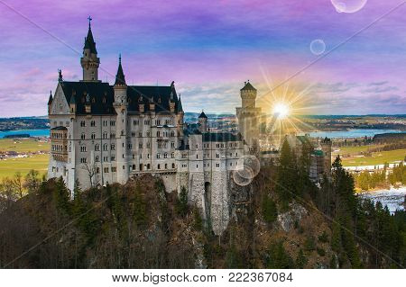 Romantic view of Neuschwanstein castle during sunrise in Germany
