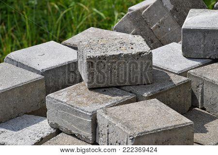 concrete blocks background, close-up of grey flagstones for sidewalk
