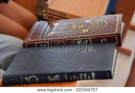 HAR HEBRON, ISRAEL - JUNE 6, 2008: Jewish holy books in synagogue