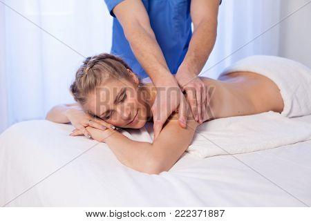 girl masseur doing massage in spa health