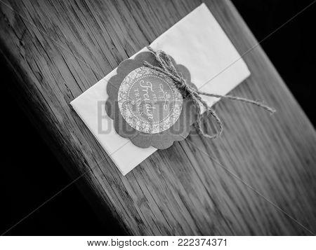 Woman hand flirting with handkerchiefs black and white
