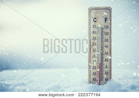 Thermometer On Snow Shows Low Temperatures Under Zero. Low Temperatures In Degrees Celsius And Fahre