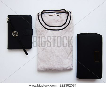 Women's items: sweater, wallet, ebook and watch