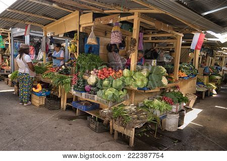 Ibarra, Ecuador-January 5, 2018: vendor stands at the Amazonas fresh produce market in the center of the city