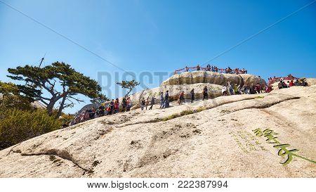 Mount Hua, Shaanxi Province, China - October 06, 2017: Tourists Queue To Climb Huashan Mountain, One