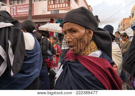 Otavalo, Ecuador - January 13, 2018: closeup of an indigenous quechua woman walking throught th Saturday artisan market