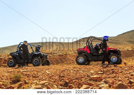 Merzouga, Morocco - February 21, 2016: Four Riders From Two Quad Atvs Stand Beside Their Vehicles On