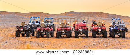 Merzouga, Morocco - February 25, 2016: A Group Of Atvs And Motorbikes Lined Up Ready To Go On A Saha