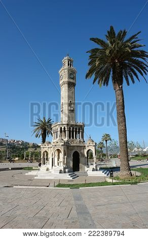 Izmir, Turkey - April 22, 2012: Saat Kulesi (Clock Tower) in the central square of Konak in Izmir in the morning, Turkey. Saat Kulesi (Izmir Clock Tower) is a symbol of the city and its most famous landmark.