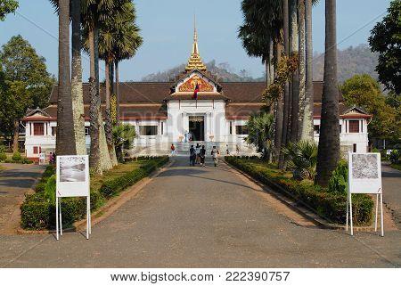 LUANG PRABANG, LAOS - FEBRUARY 14, 2007: Unidentified tourists visit Haw Kham Royal Palace in Luang Prabang, Laos.