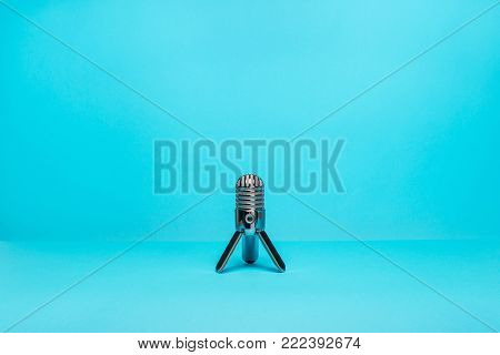 equipment for audio recording on blue background. Microphone.