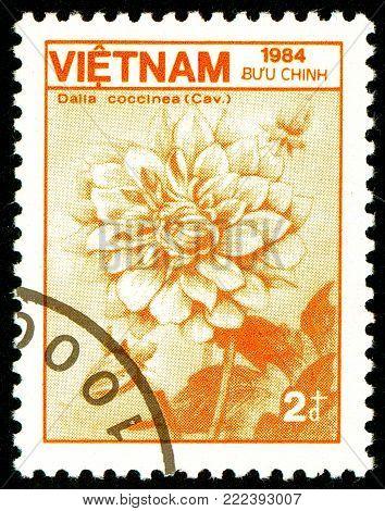 Ukraine - circa 2018: A postage stamp printed in Vietnam show flower Dahlia coccinea. Series: Fauna and Flora. Circa 1984.