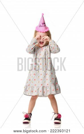 Young girl kid stressed shout in birthday party pink cap isolated on a white background