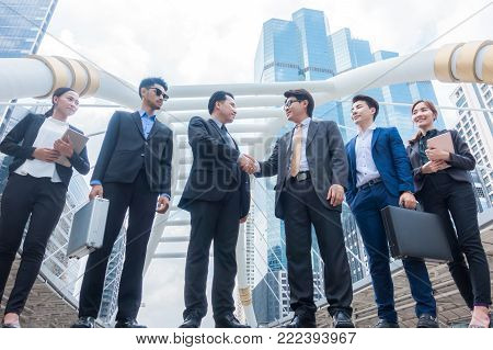 Business people shaking hands, finishing up a meeting. Negotiation benefits concept