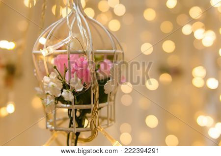 flower hanging birdcage wedding decoration with bokeh