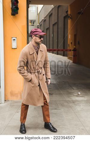 MILAN, ITALY - JANUARY 15: Fashionable man poses outside Armani fashion show during Milan Men's Fashion Week on JANUARY 15, 2018 in Milan.