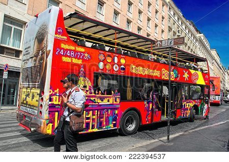 Rome, Italy -  APRIl 7, 2017 : Tourist bus with passengers on street in Rome, Italy.