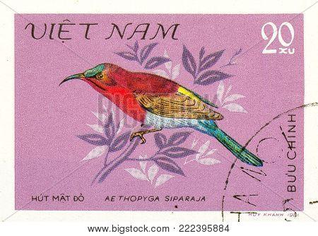 Ukraine - circa 2018: A postage stamp printed in Vietnam show Crimson Sunbird or Aethopyga siparaja. Series: Birds. Circa 1981.