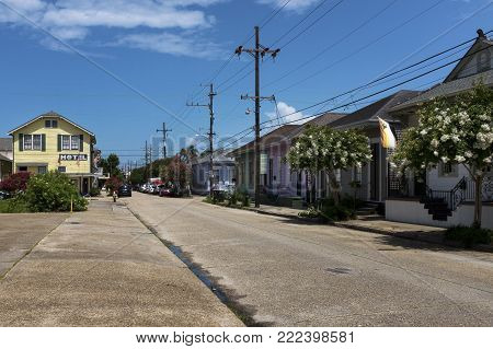 New Orleans, Louisiana - June 17, 2014: View of a street with colorful houses in the Marigny neighborhood in the city of New Orleans, Louisiana, USA