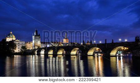 Prague, Czech Republic - October 6, 2017: Beautiful night view of Charles Bridge and Vltava river, Prague, Czech Republic.  Charles Bridge and Vltava river with night lights.