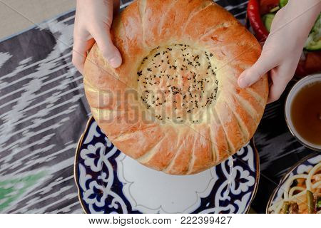 BREAD UZBEKSKY,DRINK SAMARKAND TRADITIONAL,BREAD FROM TANDYRA
