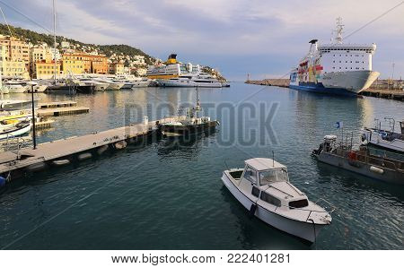 NICE, FRANCE - December 2017: ferryboat and yachts in port of Nice, Cote d'Azur, French Riviera at sunset