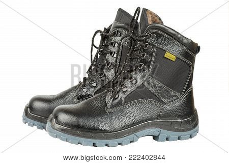 Black winter work boots isolated on white background.
