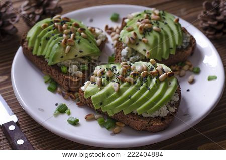 Bruschetta With Blue Avocado Cheese And Pine Nuts