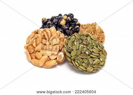 Korean traditional sweet snacks with peanuts, pumpkin seeds, black soybeans and chinese buckwheat, isolated on a white