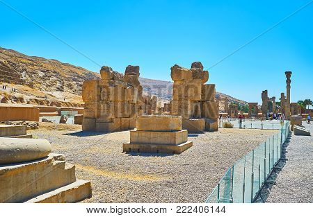 PERSEPOLIS, IRAN - OCTOBER 13, 2017: The ruins of Unfinished Gate at the foot of Rahmet Mount in Persepolis archaeological site, on October 13 in Persepolis.