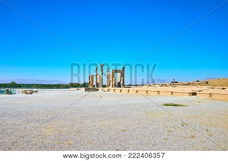 Persepolis archaeological site is located on plateau at the mountain foot, stone ruins of All Nations Gate are perfectly seen from different points of complex, Iran.