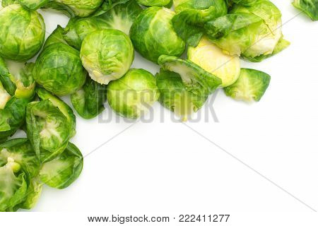 Boiled Brussels sprout heads with separated leaves in the corner top view isolated on white background