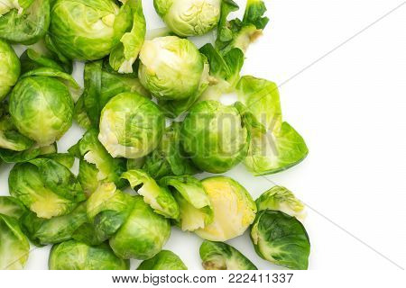 Boiled Brussels sprout heads with separated leaves top view isolated on white background