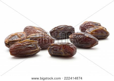 Date fruit Medjool isolated on white background ripe and dried