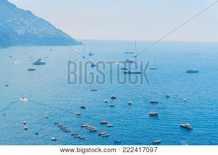Tyrrhenian Sea waters with leasure boats, Amalfi coast, Italy