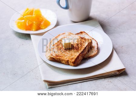 Toast Bread On White Plate.