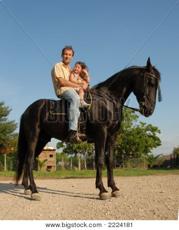 poster of riding father and little girl on a black horse