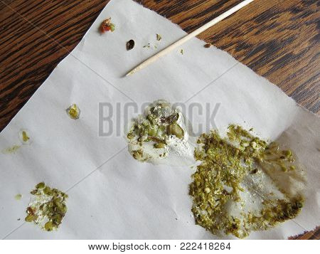 Bird droppings from a parrot containing undigested food. Indicative of ill health such as PDD (proventricular dilatation disease), chlamydia, liver issues and other conditions.