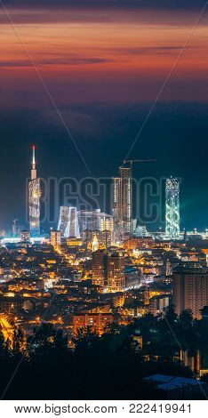 Batumi, Adjara, Georgia. Beautiful Aerial View Of Urban Cityscape At Sunset. Town At Evening Blue Hour time. City In Night Lights Illumination