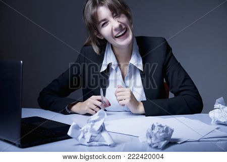 Portrait Of Young Business Woman Working Overtime And Hysterically Laughing.  (body Language, Gestur