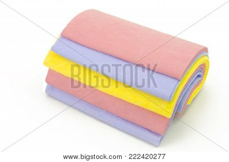 Cleaning rags a set of colorful washcloths isolated on white
