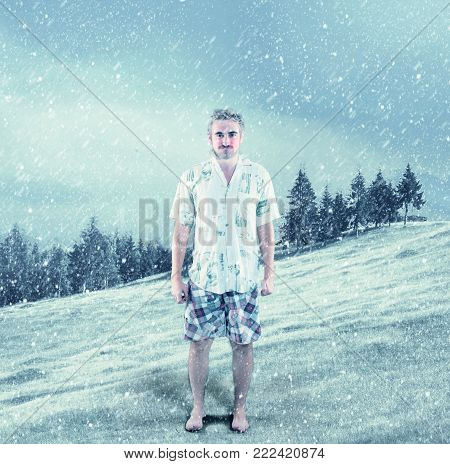 Young Man Dressed In Summer Clothes In Snow.