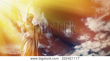 Antique Sstatue Of Wonderful Angel In The Rays Of The Sunl On Sky Background (architecture, Sculptur