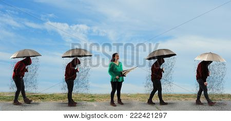 People with umbrella walking in a row in a sunny day and one noticed it was not raining . The concept of positivity