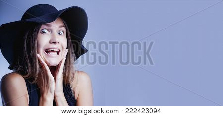 Portrait Of A Young Woman Looking In Fear With Her Hand On Face (gestures, Body Language, Psychology