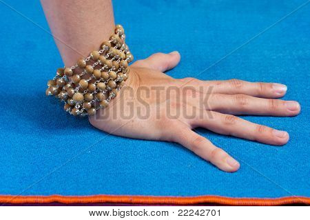 Close Up Of Hand With Mala Beads