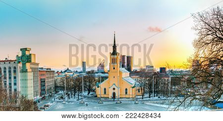 Tallinn, Estonia. Panorama Of Church Of St. John Jaani Kirik At Sunrise Time. Large Lutheran Parish Church In Tallinn Dedicated To St. John The Evangelist, Disciple Of Jesus Christ.